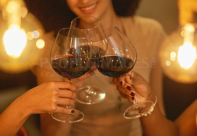 Buy stock photo Shot of a group of female friends clinking wine glasses