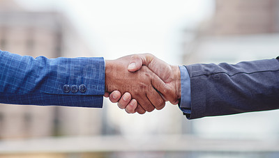 Buy stock photo Cropped shot of two unrecognizable businessmen shaking hands outside
