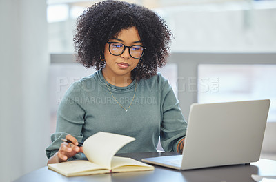 Buy stock photo Shot of an attractive young businesswoman sitting alone in her office and working