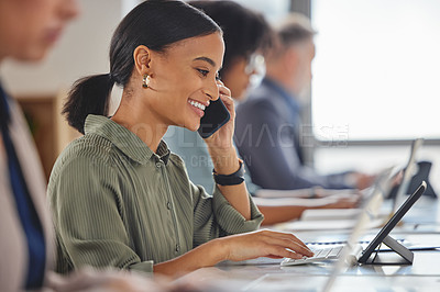 Buy stock photo Shot of a young businesswoman talking on a cellphone while working on a digital tablet in a call centre