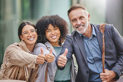 Buy stock photo Shot of a group of business people giving the thumbs up