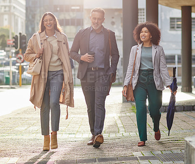 Buy stock photo Shot of a group of colleagues walking around together
