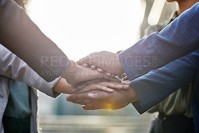 Buy stock photo Shot of a group of business people with their hands stacked together