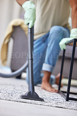 Buy stock photo Shot of an unrecognizable person vacuuming at home