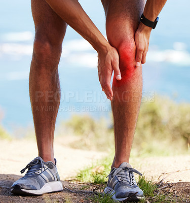 Buy stock photo Cropped shot of an unrecognizable man standing alone outside and suffering from a knee injury during his run