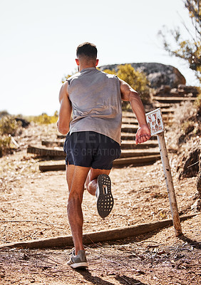 Buy stock photo Full length shot of an unrecognizable man running alone outdoors