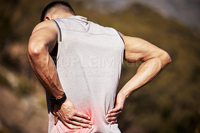 Buy stock photo Shot of an unrecognizable man standing alone outside and suffering from backache during his run