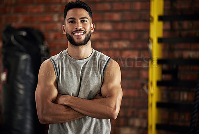 Buy stock photo Portrait of a young man working out in a gym