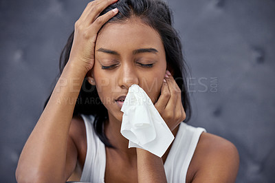Buy stock photo Shot of a woman feeling ill while sitting at home
