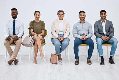 Buy stock photo Studio portrait of a group of businesspeople sitting in line against a white background