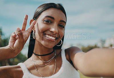 Buy stock photo Shot of a young woman taking a selfie in the city