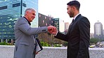 The older gentleman's not accustomed to these fist bumps